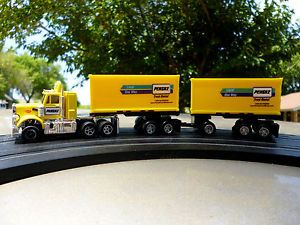 AFX Aurora AW Lighted Peterbilt w 2 Penske Truck Rental Pup Trailers