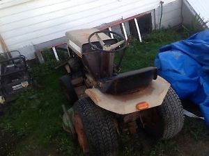 Tractor Comes With Snow Plow, Lawn Mower Deck, Tire Chains, Weights