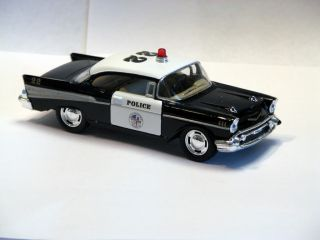 Die Cast Black White Police Car 1957 Chevrolet Chevy Pull Back Rolling Action