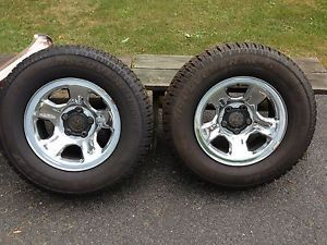 265 70 R 17in Dodge RAM 5 Lug Chrome Rims with Studded Cooper Snow Tires