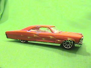 Hot Wheels 2007 Mystery Cars '65 Pontiac Bonneville Red with Flame Decoration