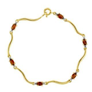 14 Karat Yellow Gold Over Sterling Silver Garnet and Diamond Bracelet Jewelry